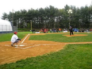 Mayor Robert Klaus throws out the first pitch to Councilman Robert Delvecchio to open the 2012 season.