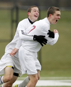 Jesse Weick, left, congratulates Tyler Selby after scoring the first goal in the first half of the state title game Saturday in Ewing. (Aristide Economopoulos/The Star-Ledger)