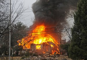 An explosion Saturday afternoon hospitalized two and leveled a multi-unit dwelling. (Photo from Philly.com)
