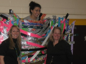 Woodland School teacher Rachel Seiden -- taped to a wall.