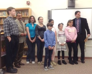 Photo from The Retrospect: Woodland School principal David Zucker announced the Barrington Students of the Month for February at the borough school board's meeting on Mon., March 11: fifth graders Tyana Henderson, Rebecca Styer and Stephan Tonuci; sixth graders Zack Fiorani and Will Ciecchon; seventh graders Stephen Cross and Angelica Opperman and eighth graders Kyle Cross and Ruth Gallagher. With them is Superintendent Anthony Arcodia.