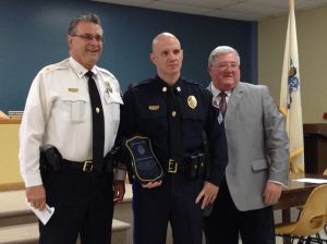 Police Chief Joe Eisenhardt and Mayor Robert Klaus honor police Sgt. Dave Uron for saving a man's life. (Photo courtesty of TheRetrospect.com and Facebook.com/TheRetrospect)