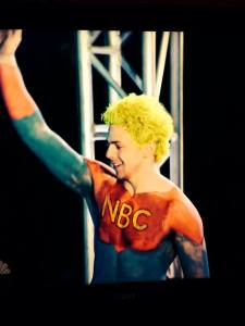 In a savvy marketing move, Jamie Rahn, 24, of Barrington succeeded in standing out by dying his hair a bright yellow-green and branding himself 'Captain NBC' for his appearance on 'American Ninja Warrior.'