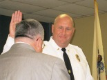 Police Chief Dave Roberts is sworn in by Mayor Robert Klaus Oct. 14, 2013, at Barrington Borough Hall.
